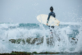 Woman surfer with surfboard going to surf the big waves - PhotoDune Item for Sale