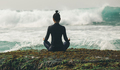 Yoga woman meditation at the seaside cliff edge facing the coming strong sea waves - PhotoDune Item for Sale
