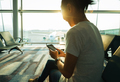 woman using cellphone in airport - PhotoDune Item for Sale