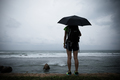 woman with umbrella in the storm seaside - PhotoDune Item for Sale
