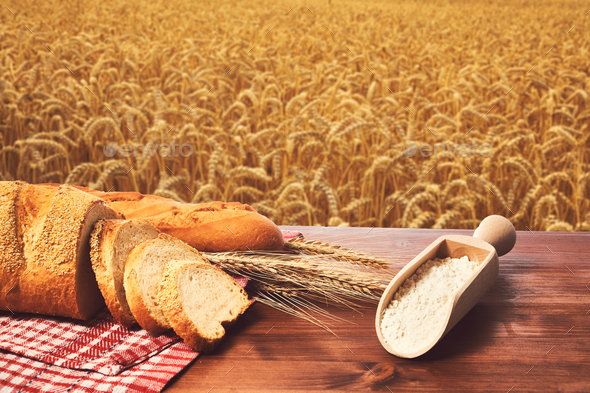 Bread wheat and flour on the table - Stock Photo - Images