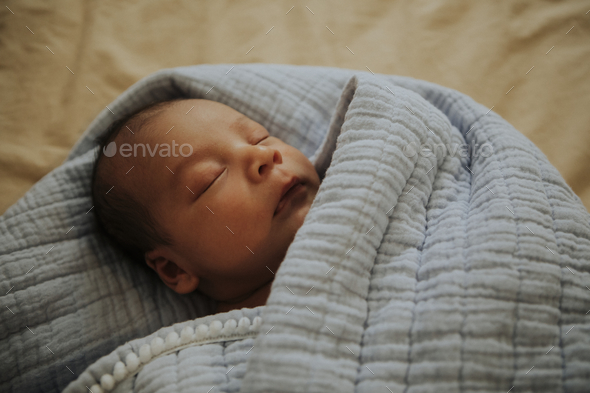 Infant baby fast asleep on the bed - Stock Photo - Images