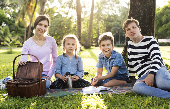 Family having a picnic in the park - Stock Photo - Images