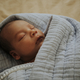Infant baby fast asleep on the bed - PhotoDune Item for Sale