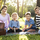 Family having a picnic in the park - PhotoDune Item for Sale