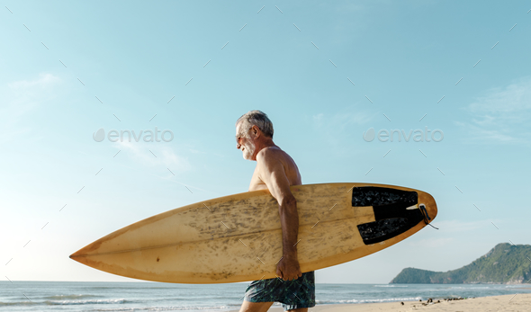 Surfer at a nice beach - Stock Photo - Images