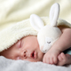 Newborn baby boy on white carpet closeup - PhotoDune Item for Sale