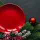 Christmas table with red plate and spruce and bullets. New Year's holiday background - PhotoDune Item for Sale