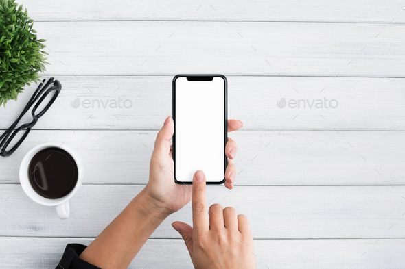 Hand using smartphone on white wooden background - Stock Photo - Images