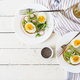 Healthy food. Breakfast. Avocado egg sandwich with whole grain bread on white wooden background.  - PhotoDune Item for Sale