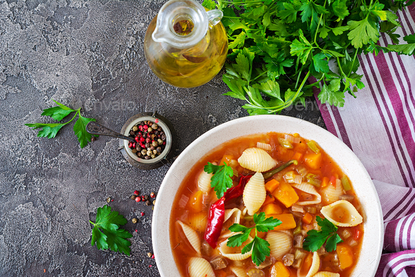 Minestrone, italian vegetable soup with pasta on  table. Vegan food. Top view - Stock Photo - Images