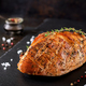 Roasted Christmas ham of turkey on dark rustic background.  Festival food. - PhotoDune Item for Sale