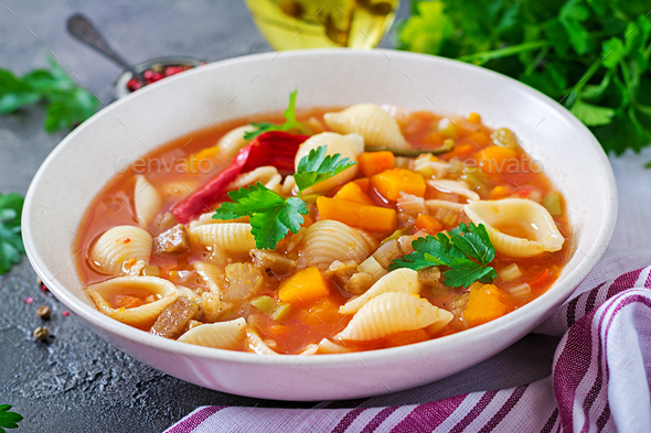 Minestrone, italian vegetable soup with pasta on  table. Vegan food - Stock Photo - Images