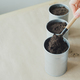 womans hand puts soil in metallic shovel into flowerpot - PhotoDune Item for Sale