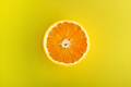 Half of the orange on yellow background - PhotoDune Item for Sale