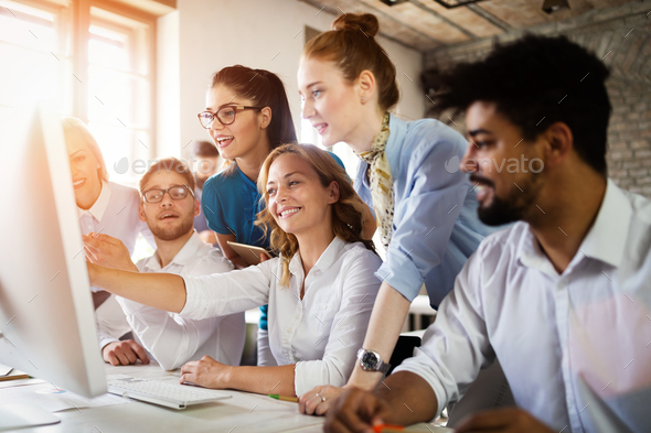 Group of young businesspeople or designers work with new startup project in office - Stock Photo - Images