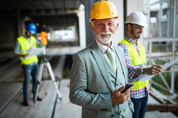 Group of construction engineer working in construction site - Stock Photo - Images