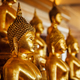 Golden Buddha statues in buddhist temple - PhotoDune Item for Sale