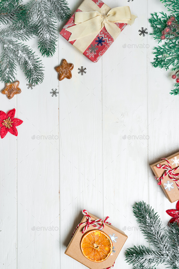 Christmas Ornament Background.Christmas Congratulation Background With Gifts Pine Branches And Christmas Ornaments On The Wooden