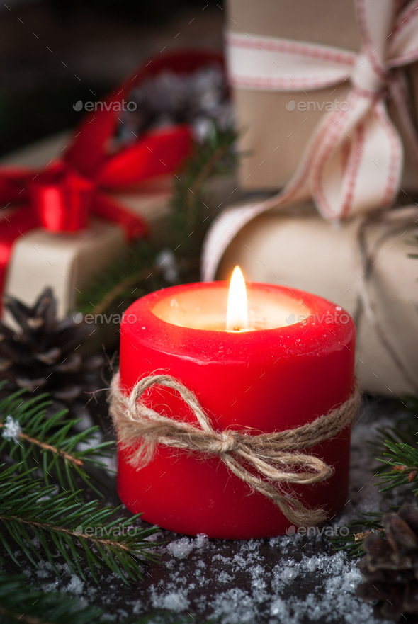 Christmas candle present and decorations - Stock Photo - Images