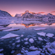 Floating ice in the sea against snowy mountains and pink sky - PhotoDune Item for Sale