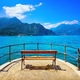 Bench on lakefront in Como Lake landscape. Bellagio Italy - PhotoDune Item for Sale