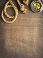 ship compass and rope at wooden background - PhotoDune Item for Sale