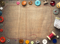 sewing tools and accessories on wooden table - PhotoDune Item for Sale