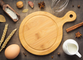 cutting board and bakery ingredients on wooden background - PhotoDune Item for Sale