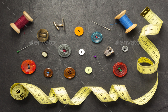 sewing tools and accessories on slate stone - Stock Photo - Images