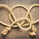 ship rope at wooden background - PhotoDune Item for Sale