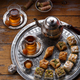 Traditional Turkish tea with oriental sweets, rustic copy space - PhotoDune Item for Sale