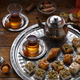 Assorted oriental sweets with tea in traditional cups, copy space - PhotoDune Item for Sale