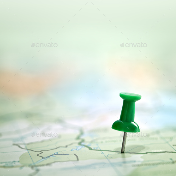 Thumbtack showing destination location on map with copy space