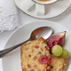 Fruits cake and tea cup on a table - PhotoDune Item for Sale