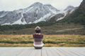 Young woman traveler sitting and looking beautiful landscape - PhotoDune Item for Sale