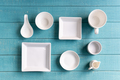 Various empty white plates and bowls on wooden background, Top view - PhotoDune Item for Sale