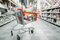 Cart full of goods in supermarket, nobody - PhotoDune Item for Sale