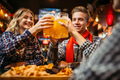 Football fans drinks beer in sports bar - PhotoDune Item for Sale