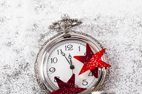 New Year's at midnight - Old clock and holiday lights - Stock Photo - Images