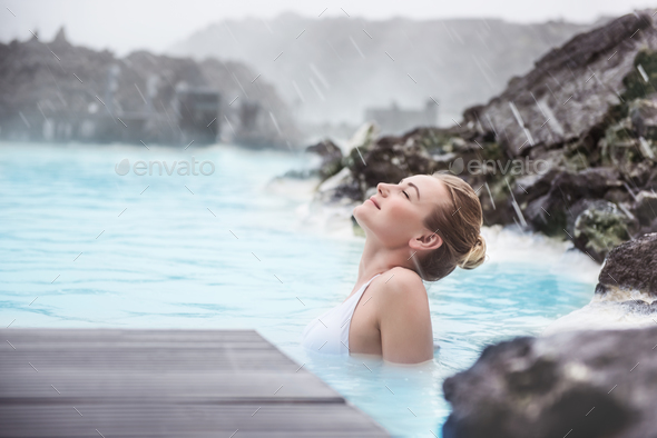 Woman enjoying blue lagoon - Stock Photo - Images