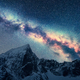 Milky Way above snowy mountains at night. Space - PhotoDune Item for Sale