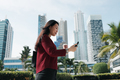 Chinese Woman With Phone Walking And Drinking Coffee - PhotoDune Item for Sale