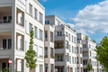 Row of white modern apartment houses seen in Berlin - PhotoDune Item for Sale