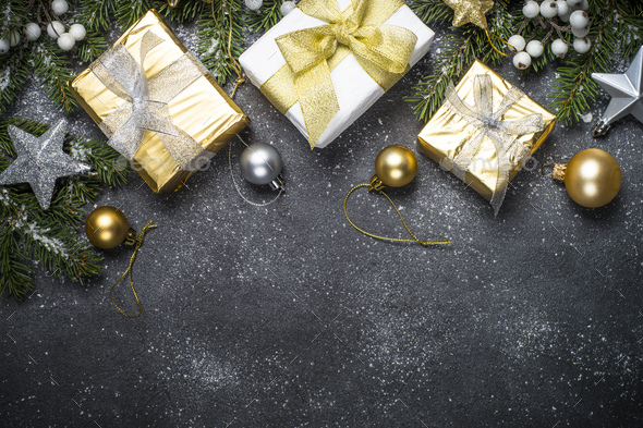 Christmas background with gold and silver decorations on black - Stock Photo - Images
