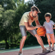 Family playing basketball outdoors - PhotoDune Item for Sale