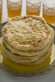 Stack of traditional Moroccan meloui pancakes topped with butter - PhotoDune Item for Sale