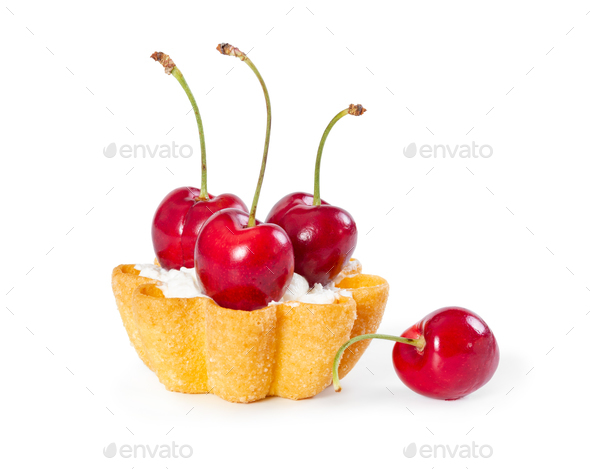 Tartlet with fresh cherries and cream isolated on white