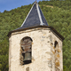 Antique stone church bell tower detail with forest background. Vertical - PhotoDune Item for Sale
