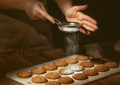 woman preparing biscuits on wooden table. - PhotoDune Item for Sale